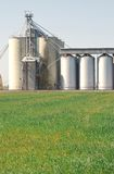 Grain processing plant with field in foreground Royalty Free Stock Photos