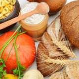 Grain products and vegetables. On white Royalty Free Stock Photo