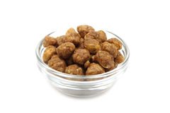 Grain roasted peanuts in a glass dish Stock Photography