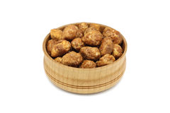 Grain roasted peanuts in a wooden bowl Stock Photo