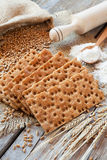 Grain rye Crispbread, cereal crackers on rustic table Stock Image