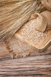 Grain in sacks and ears of wheat Royalty Free Stock Image