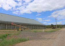 A grain shed and auger Royalty Free Stock Photos