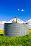 Grain Silo. Metal grain silo used to store grain and other farm crops Stock Photo