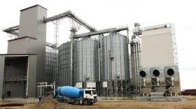 Grain silo. Steel and chrome industrial grain silo with grain dryer stock photo