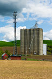 Grain silo with a cell phone tower Stock Image
