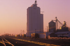 Grain silo co-op in KS at sunset Royalty Free Stock Photo