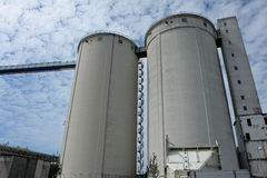 Grain silo container tanks. Giant grain silo container tanks industry agriculture modern plant Royalty Free Stock Photo