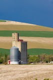 Grain silo and elevator in field Royalty Free Stock Photos