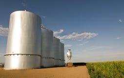 Grain silo on farm in Gilbrt,AZ. Steel and chrome industrial grain silo on farm in Gilbert,AZ stock photo