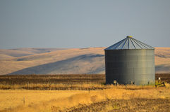 Grain Silo in Field Stock Photography