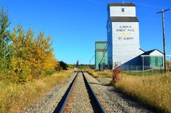 Grain Silo, Rail Wayside, Western Canada. Grain Silo in St Saint Albert, Alberta, Western Canada Prairies adjacent to rail ing line spur in fall colours royalty free stock photo