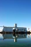 Grain Silo Reflection. Waterfront Grain Silo Reflected near Seaport Loading Docks stock image