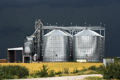Grain silos. View of grain silos against stormy sky Stock Photos