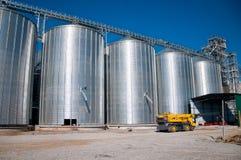 Grain Silos. Silver Grain Silos with blue sky in background stock image