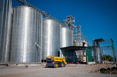 Grain Silos. Silver Grain Silos with blue sky in background royalty free stock photo