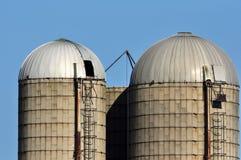 Grain Silos. Two grain storage silos on a farm Royalty Free Stock Photos