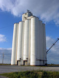 Grain Silos. Blue skies backdrop the grain silos in northwestern Oklahoma wheat country Stock Images