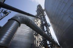 Grain Silos. A view looking up at grain silos royalty free stock images