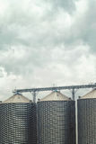Grain silos on cloudy day Royalty Free Stock Images