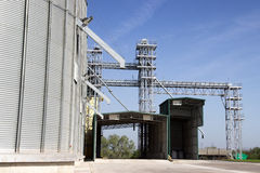 Grain silos. Complex with bright blue sky in the background Royalty Free Stock Photos