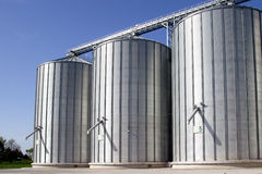 Grain silos. Complex with bright blue sky in the background Royalty Free Stock Image