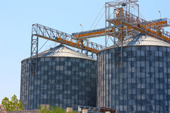 Grain Silos Construction. In summer day stock photos