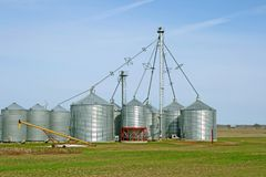 Grain silos on a farm in spring Stock Image