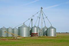 Grain silos on a farm in spring Stock Image