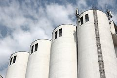 Grain silos. At a vegetable oil factory in France. Food production industry stock photos
