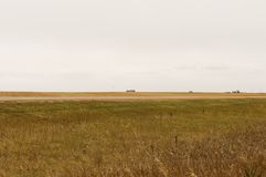 Grain silos on the prairie horizon Stock Photos
