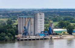 Grain silos. Next to river stock photos