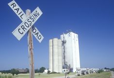 Grain silos and a railroad crossing in Hope, Arkansas Royalty Free Stock Photos
