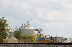 Grain silos by railroad tracks Royalty Free Stock Photography