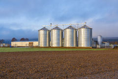 Grain Silos in rural landscape Royalty Free Stock Images