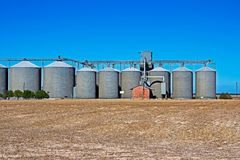 Grain silos in South Africa. Grain silos with parched field in drought ridden Western Cape, South Africa stock photography