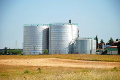 Grain Silos. Wheat field and countryside scenery Royalty Free Stock Photography