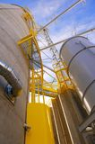 Grain Silos with Yellow Safety Areas Stock Image