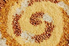 Grain spiral. Spiral made of couscous, buckwheat, bulgur and rice stock photography