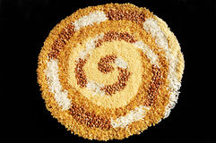 Grain spiral. Spiral made of couscous, buckwheat, bulgur and rice stock images