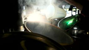 Grain sprinkle into steaming brewery kettle. Sprinkle the entire content of Measuring cup stock video