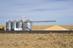Grain storage silos with conveyor royalty free stock photography