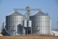 Grain storage silos. Farm. Agricultural silos. Warehouse building stock photos