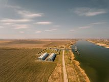 Grain storage silos and grain elevator at the port. Stock Photo
