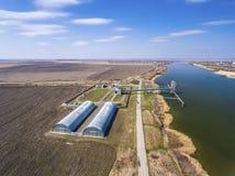Grain storage silos and grain elevator at the port. Stock Photos
