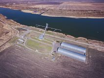 Grain storage silos and grain elevator at the port. Royalty Free Stock Image
