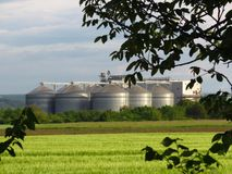 Grain storage steel silos. Silo system. Flat bottom silos, flat bottom bins. Grain storage steel silos. Silo system. Flat bottom silos also called flat bottom stock photos