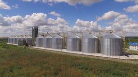 Grain storage tanks and sky. stock video footage