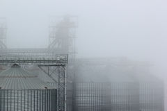 Grain terminal tanks in dense fog, Odessa, Ukraine Royalty Free Stock Photography