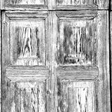 grain texture of a brown antique wooden old door in italy   euro Stock Images